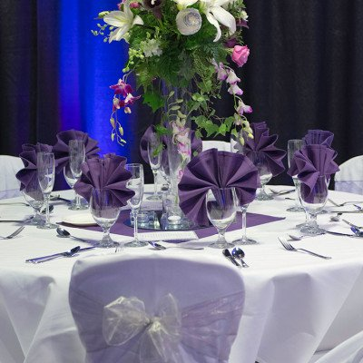 Sapphire Palace events - table setting with flower center piece - Blue Lake Casino & Hotel